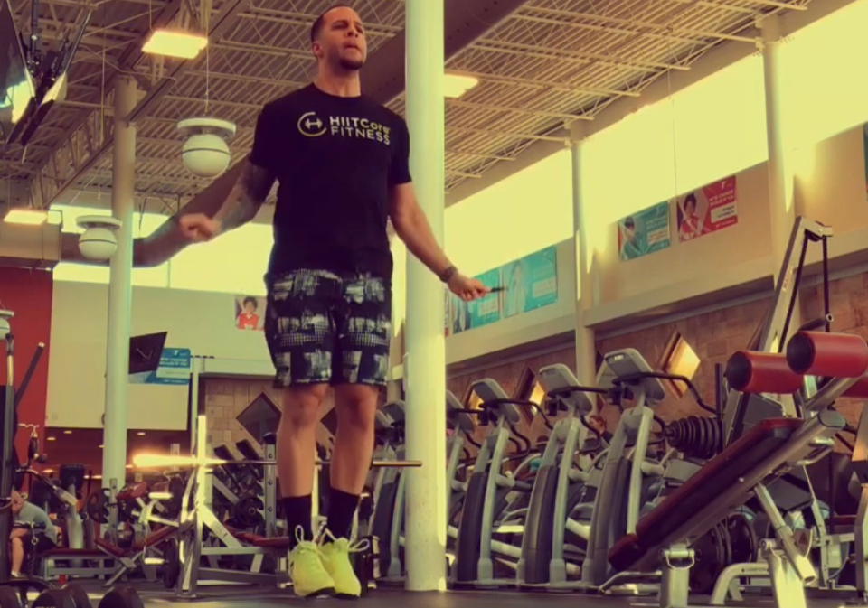 fitness man doing jump rope workout