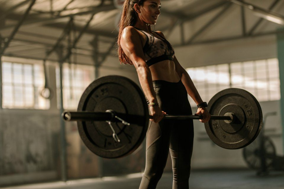 fitness woman doing deadlift exercise