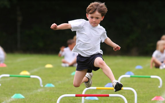 kid jumping hurdles