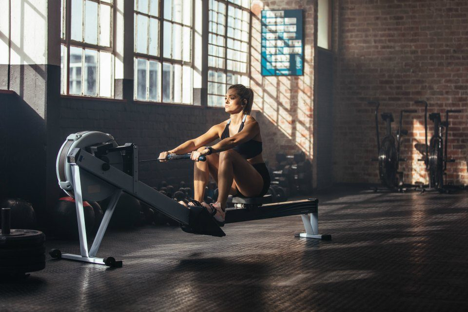 fitness woman doing rowing exercise